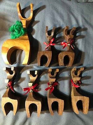 Vintage set of 7 Mid Century wood hand carved reindeer