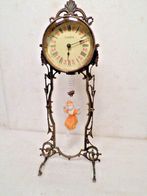 Very Unusual Bouncing Doll Clock--The Doll Is The Pendulum