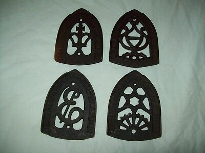 lot of  4 Antique cast iron  sad iron trivets Cleveland Foundry ,Colbrook