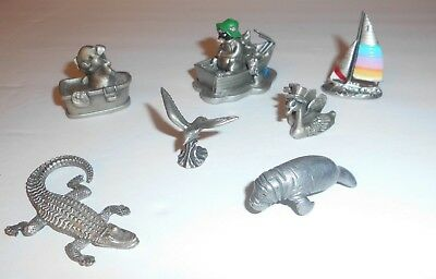 Lot of 7 Miniature Pewter Figurines Pig Racoon Gator Gull Manatee Swans Sailboat