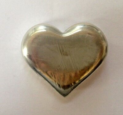 1oz hand poured tin heart bar 999 fine. The heart isnt silver, it is pure tin.