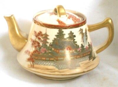 C19Th Japanese Satsuma Tea Pot And Cover Decorated With A Temple Scene