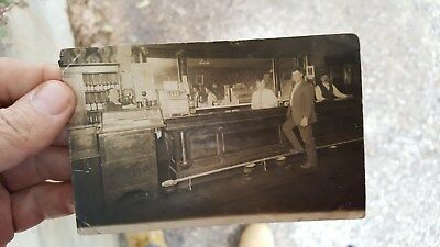 early RPPC Real Photo Postcard of a Saloon, Slot Machine on Counter,Cigars etc