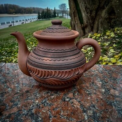 Ceramic kettle in ancient Greek style. Handmade from red clay.