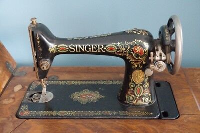 1910 Treadle Singer Sewing Machine in original Cabinet, works, with attachments