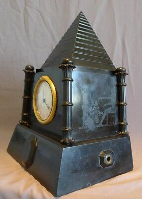 A fabulous and very rare antique English, Egyptian revival mantel clock with fus