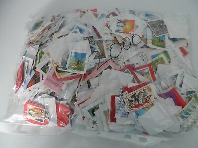 lot 10 approx  2000 christmas stamps on & off paper G.B approx 375grms