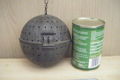 large metal ball chinese/tibetan? could be incense burner.