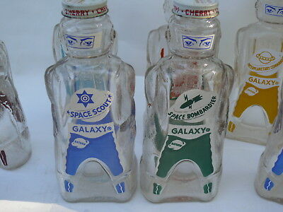 9 GALAXY Glass SYRUP BOTTLES Spacemen Coin Banks and Box 1950's Vintage