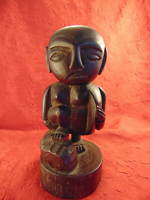 "Primitive hand carved statue Man and Rock stepping up black wood 9 1/2"" art"