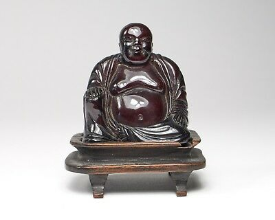 Vintage 1930s Chinese hand carved cherry amber bakelite resin buddha. wood stand