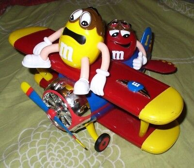 M&m's M&m Sweet Candy Big Dispenser As Plane With Yellow And Red Pilot
