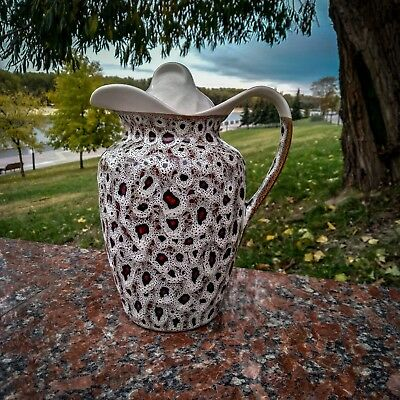 Ceramic jug with a lid for drinks. Handmade