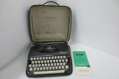 Vintage 1967 Olympia SF Deluxe Ultra portable typewriter and black case
