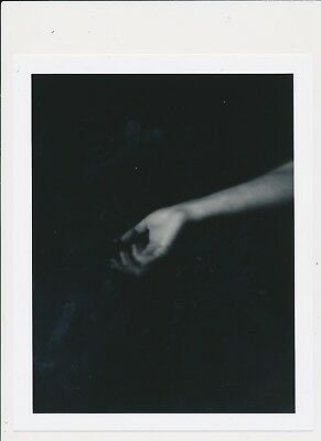 Unknown Date:Unusual Surreal Sensual Hand  Black Background 1/2 Arm Press Photo