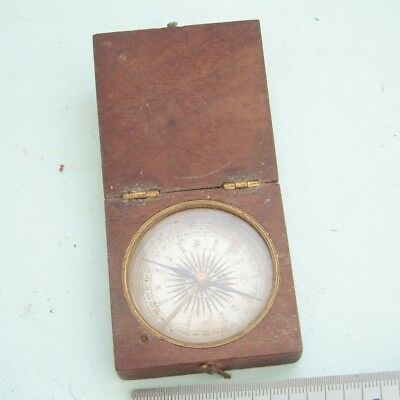 Vintage compass in old wooden box Vintage compass look very old ??