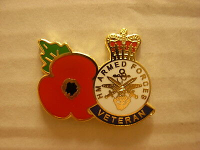 Veterans poppy pin badge. Lest we forget. H.M. Armed forces