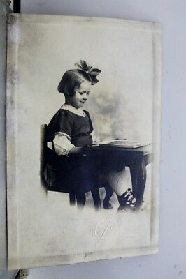 Greetings Girl Sitting at Desk Postcard Old Vintage Card View Standard Souvenir