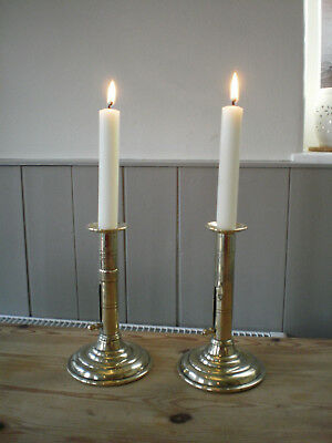 vintage two brass candlesticks round base side pushers working order