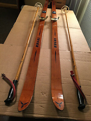 Vintage Classic Wooden Cross Country Huski Skis With Brass Bindings And Poles