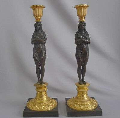 A fine pair of Omolu and Patinated bronze French Empire figural Candlesticks in