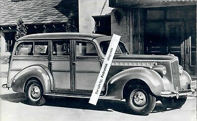 Mounted photograph of vintage 1940 era Packard Woody Wagon Car from a Exhibition