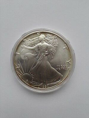 1991 1 oz Silver American Eagle BU with Toning in Airtite Capsule