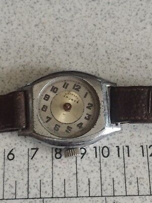 Old vintage watch.Made in Switzerland. FOR PARTS- NOT WORKING
