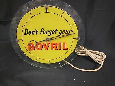 Vintage Electric Clock with Bovril Advertising to Glass Front