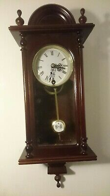 Antique style wall clock 31 days striking on a bell