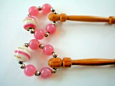 Pair of wooden lace bobbins with pretty glass spangles