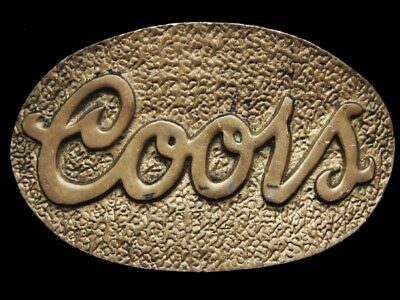 IB17109 COOL VINTAGE 1970s ***COORS*** SOLID BRASS OVAL BEER BUCKLE