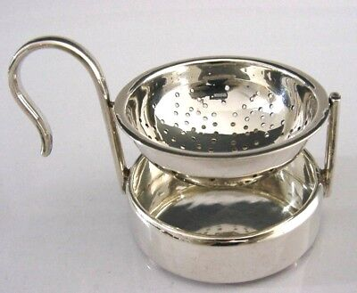 UNUSUAL SOLID STERLING SILVER TILTING TEA STRAINER & DRIP BOWL STAND c2000