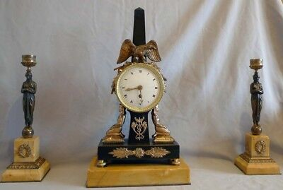 Antique Egyptian style clock set in patinated bronze and Sienna marble