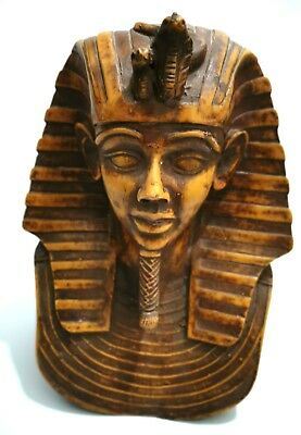 An ancient Egyptian statue in the form of a sphinx, pharaonic , made of wooden