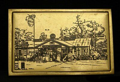 Hi20136 Vintage 1983 **Old Country Grocery** 31 Cent Gas Solid Brass Buckle