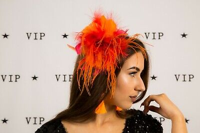 Orange and red feathered fascinator on headband Wedding Races Christening