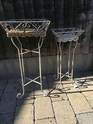 Jardinier plant stands as a pair