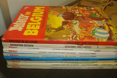 Set of 9 Asterix Books,  Mixed condition & age. Hardbacks