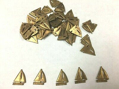 Small brass metal stamped sailboat pieces Lot of 50