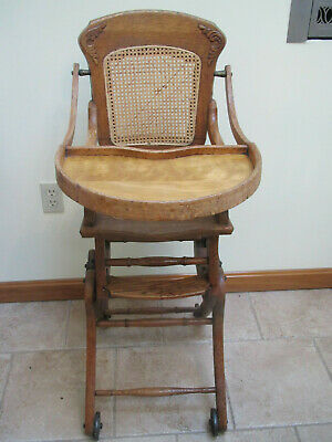 Victorian oak caned back and seat adjustable high chair(converts to a rocker) EX