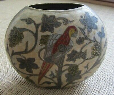 A metal vase in the cloisonne style with parrot motif