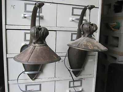 Pair of matching Victorian bronze wall sconces each sconce has a mica shade