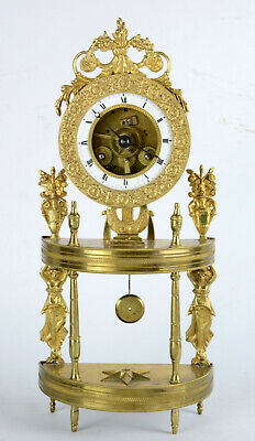 A French ormolu portico clock ormolu directoire period late 18th c. approx. 1790