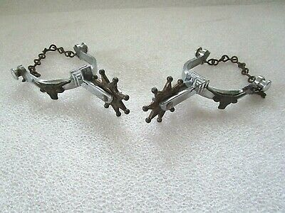 Pair of Vintage Child's Nickel Plated Spurs with Copper Brass Rowel Steer Head