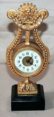 """Vintage Victorian 8 1/4"""" Tall Wind Up Clock - Sun - Woman's Face - Marble Base"""