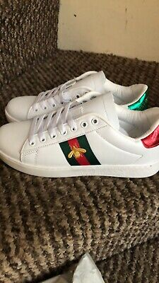 7ae7e7f12 GUCCI FALACER BEE Web Stripe embellished Red patent-leather trainers ...