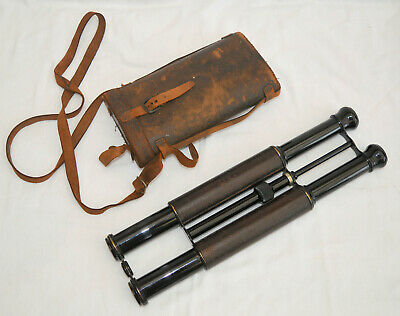 A rare, unusual set of long binoculars in case.