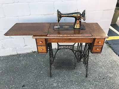 Antique 1910 Singer Treadle Sewing Machine with Oak Cabinet. Decorated Red Eye