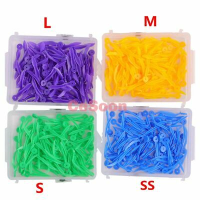 400Pcs Dental Orthodontic Plastic Wedge With Hole Round Stern 4 Colors 4 Sizes
